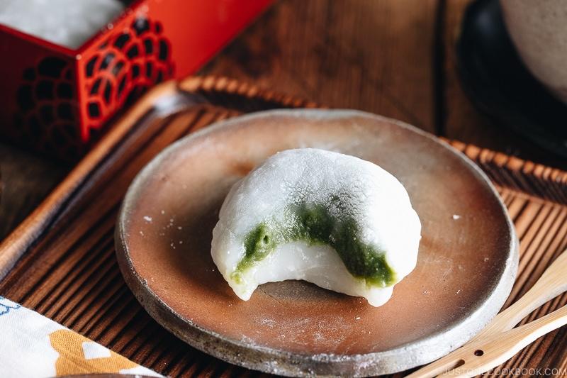 Green tea mochi showing sweet matcha filling.
