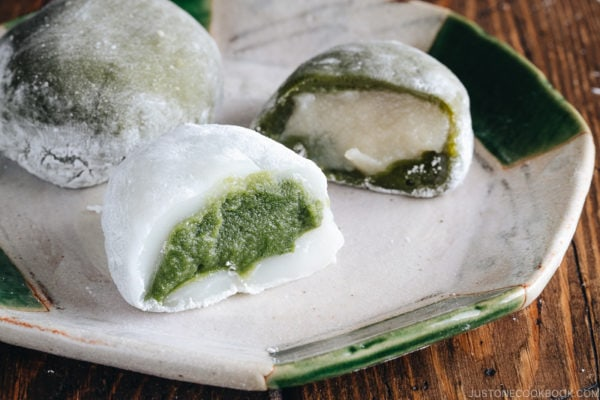 Green tea mochi showing green filling and white filling.