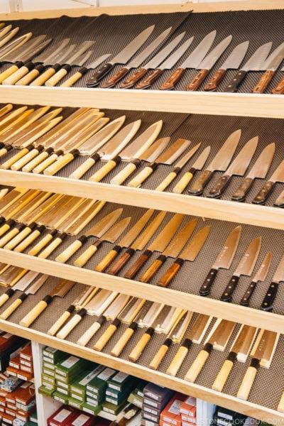 Japanese knives on a shelf.