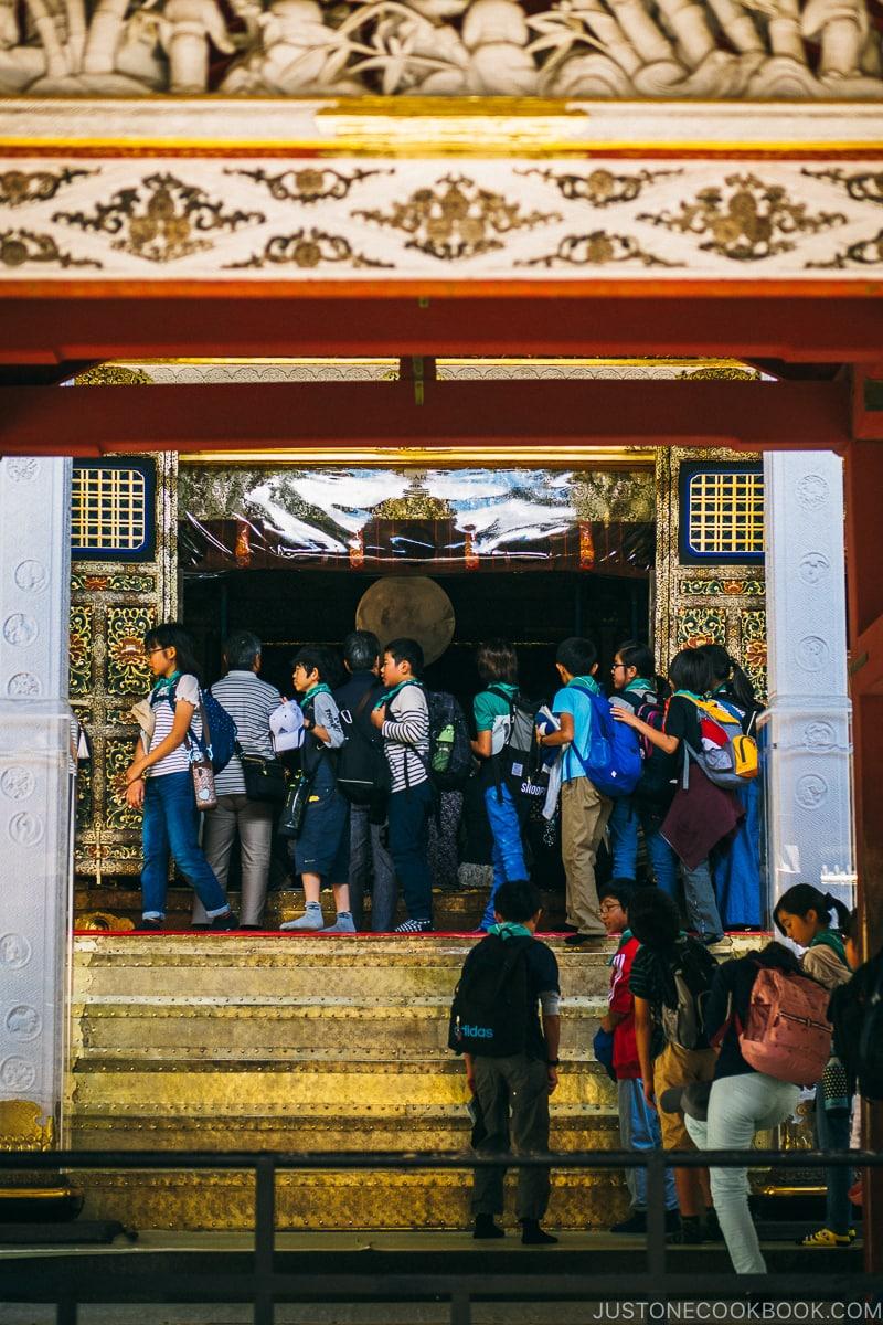 visitors walking past the main shrine - Nikko Travel Guide : Nikko Toshogu Shrine | www.justonecookbook.com