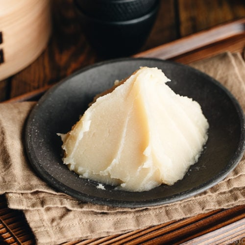 White bean paste on a Japanese black plate.