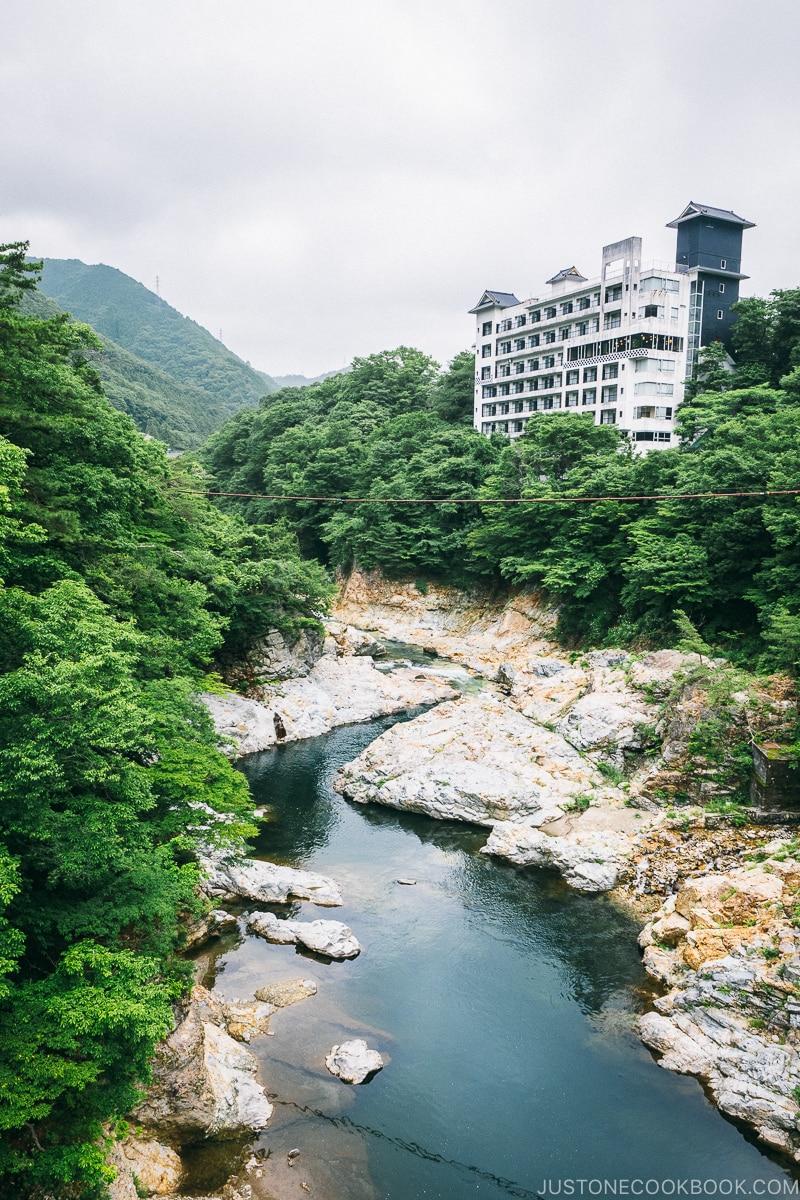 Kinugawa River with a hotel in the background - Nikko Travel Guide : Kinugawa Onsen | www.justonecookbook.com