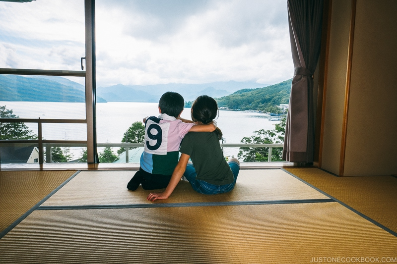 two children looking at Lake Chuzenji from room window at Hoshino Resorts KAI Nikko - Things to do around Lake Chuzenji | www.justonecookbook.com