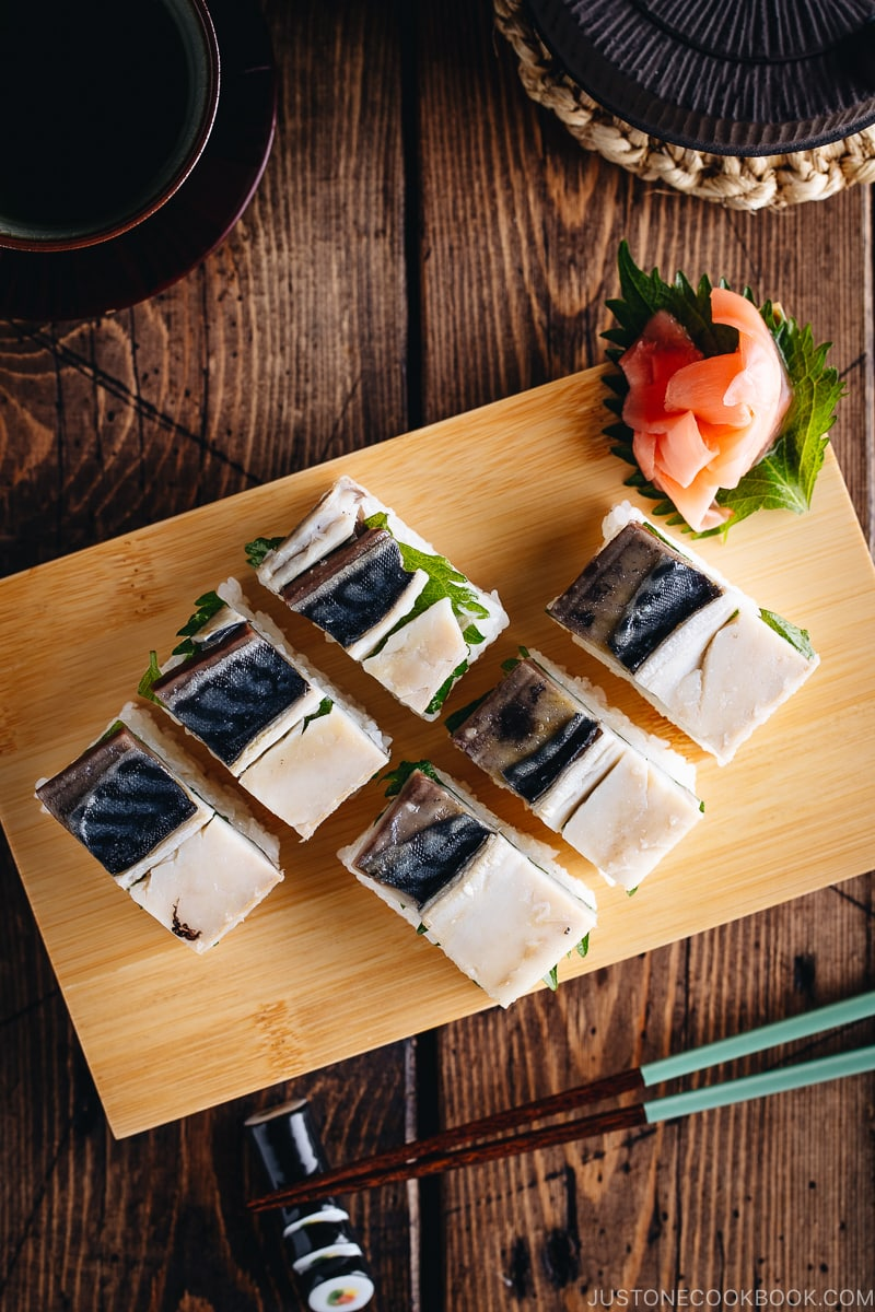 Mackerel Pressed Sushi (Saba Oshizushi) and sushi ginger are on the bamboo sushi tray.
