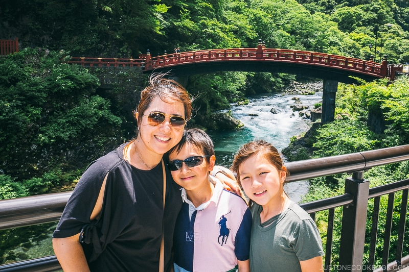 family standing in front of Shinkyo Bridge - Places to Visit and Things to do in Nikko | www.justonecookbook.com