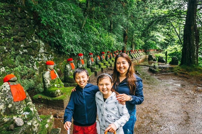 family in front of jizo statues at Kanmangafuchi Abyss 憾満ヶ淵- Places to Visit and Things to do in Nikko | www.justonecookbook.com