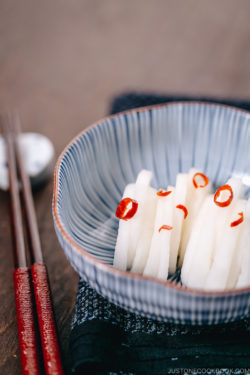 Japanese Pickled Daikon in a Japanese blue ceramic bowl.