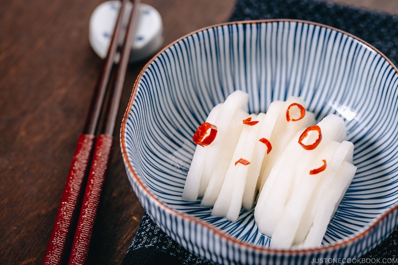 Japanese Pickled Daikon in a Japanese blue ceramic bowl.