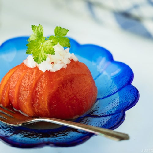 Pickled Tomatoes on a blue plate.