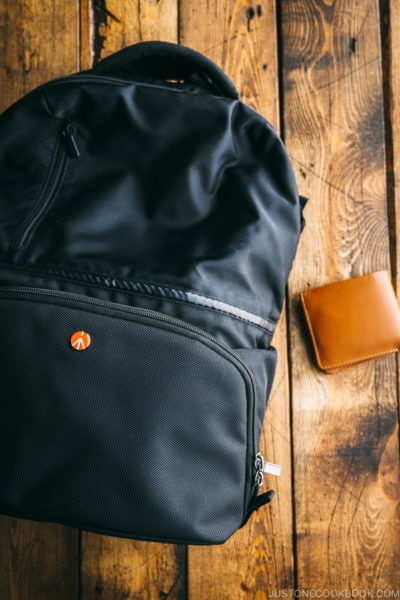 backpack and wallet on wooden boards - Lost Wallet in Japan What to Do | www.justonecookbook.com