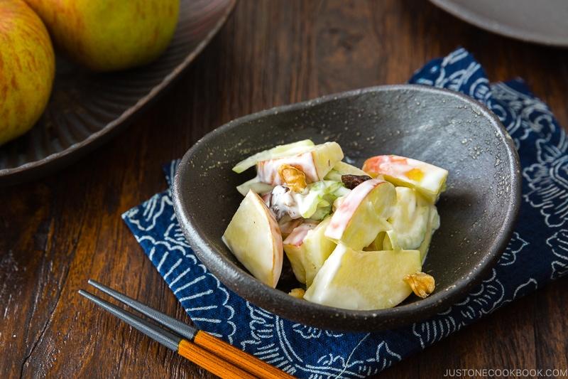Apple Walnut Salad in a black ceramic bowl.