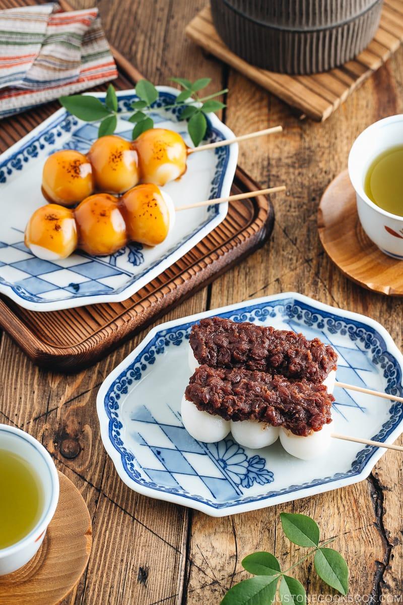 Mitarashi Dango and Dango with anko on a Japanese blue ceramic.