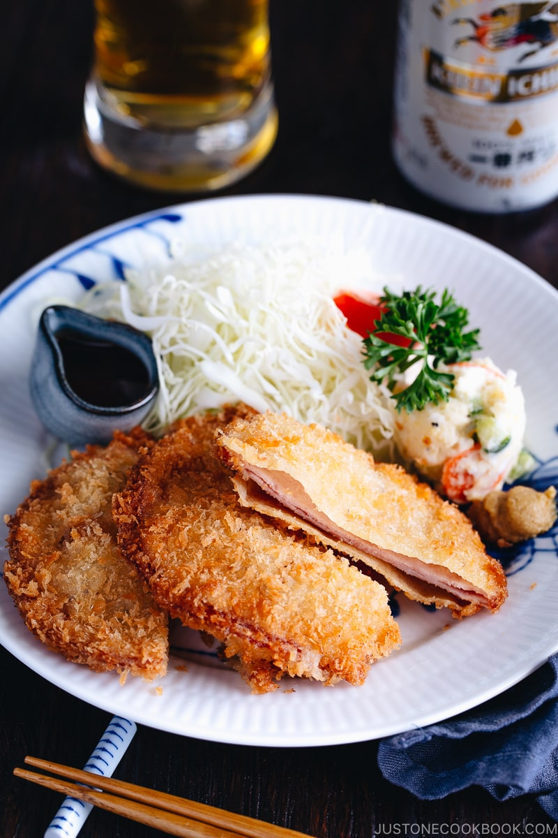 Ham Katsu served with Japanese potato salad and shredded cabbage.