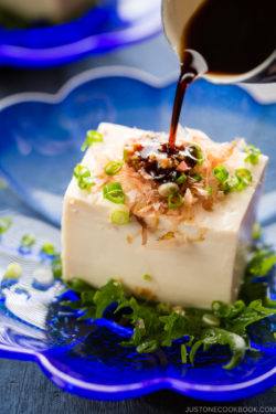 Hiyayakko (Japanese Chilled Tofu) on a blue plate.