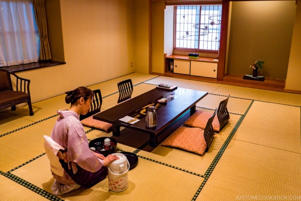 A hostess preparing tea in ryokan room