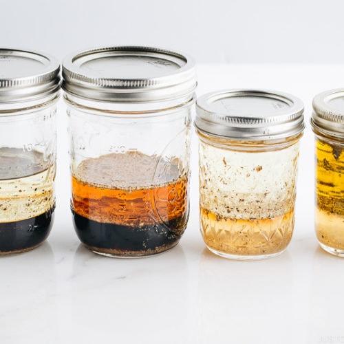 4 Japanese salad dressings in mason jars.