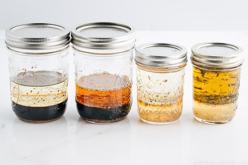 4 Japanese salad dressings in mason jars.