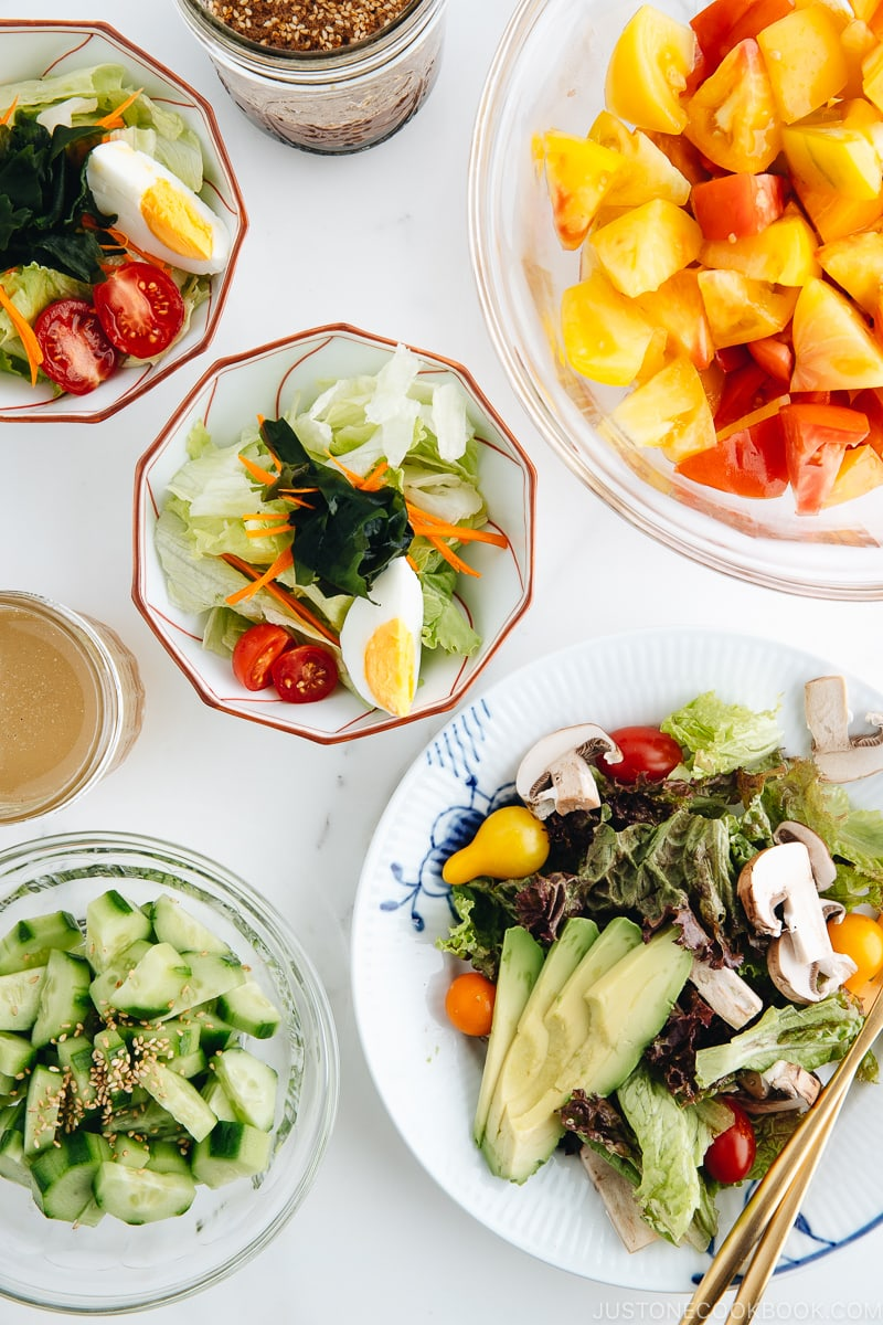 4 kinds of Japanese salads in different bowls and plates.