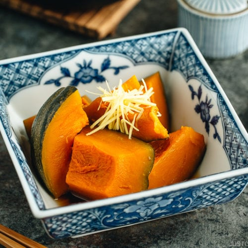 Simmered Kabocha Squash in a Japanese square bowl.