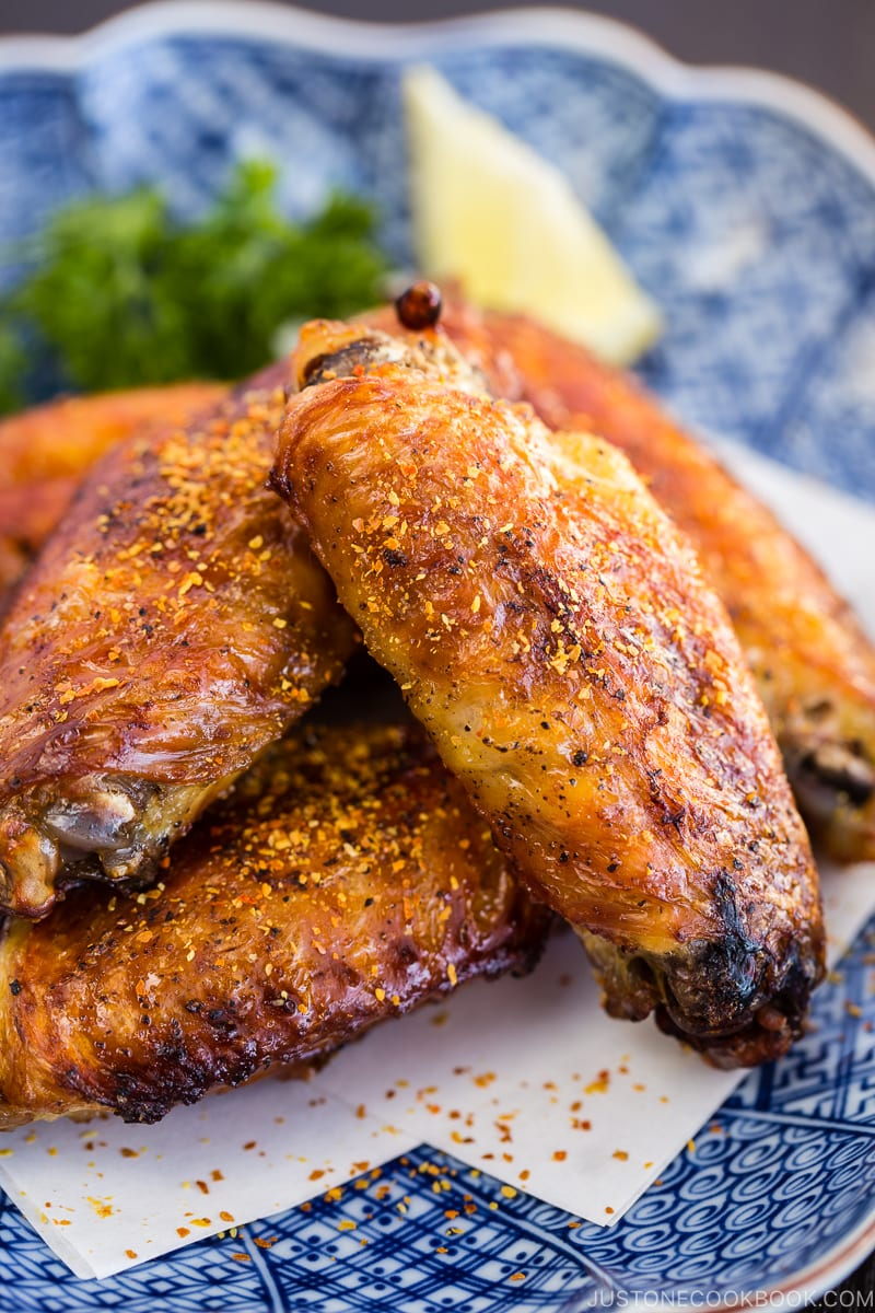 Japanese Salted Chicken Wings (Teba Shio) with sprinkle of shichimi togarashi on the Japanese plate.