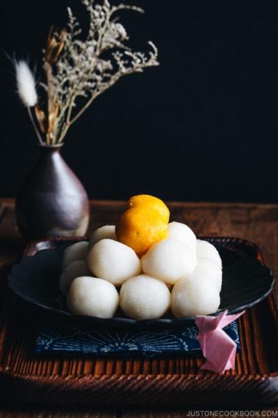Tsukimi Dango on a black plate.