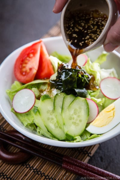 Japanese salad dressing (Wafu Dressing) over the iceberg salad.
