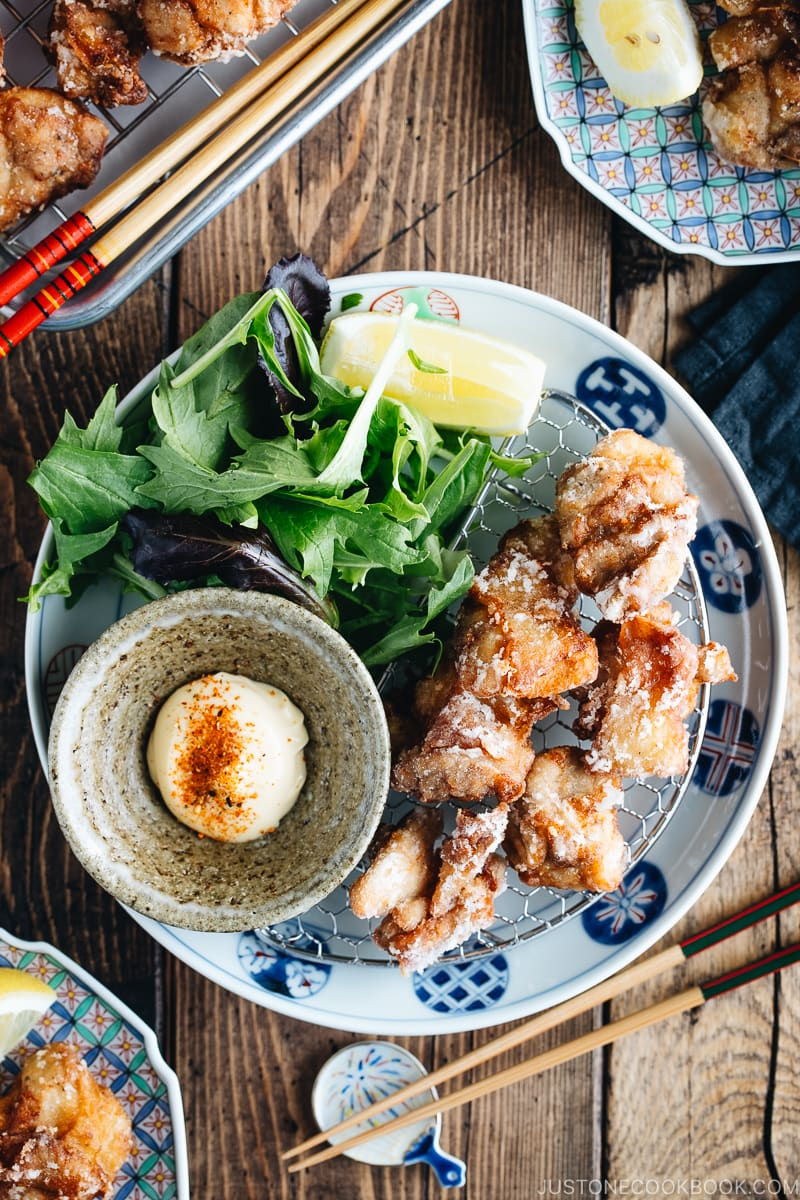 Karaage (Japanese Fried Chicken) on a Japanese plate, served with Japanese mayo.
