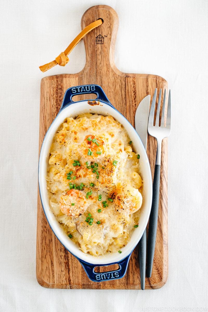 Creamy macaroni gratin in a blue STAUB gratin dish.