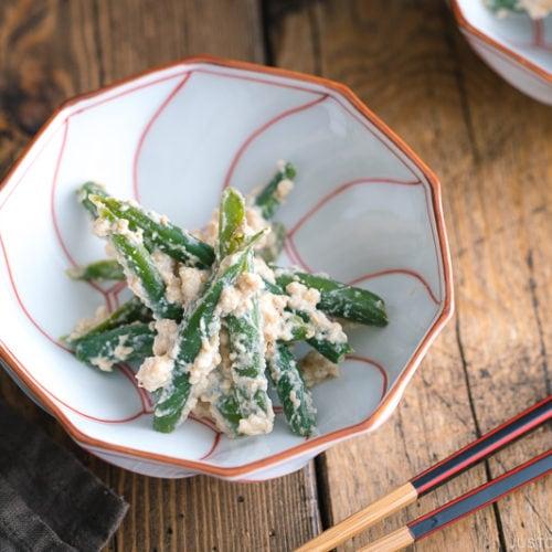 Green bean shiraae in a Japanese ceramic.