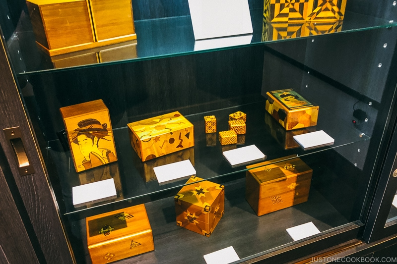 Japanese wooden puzzle boxes on a shelf