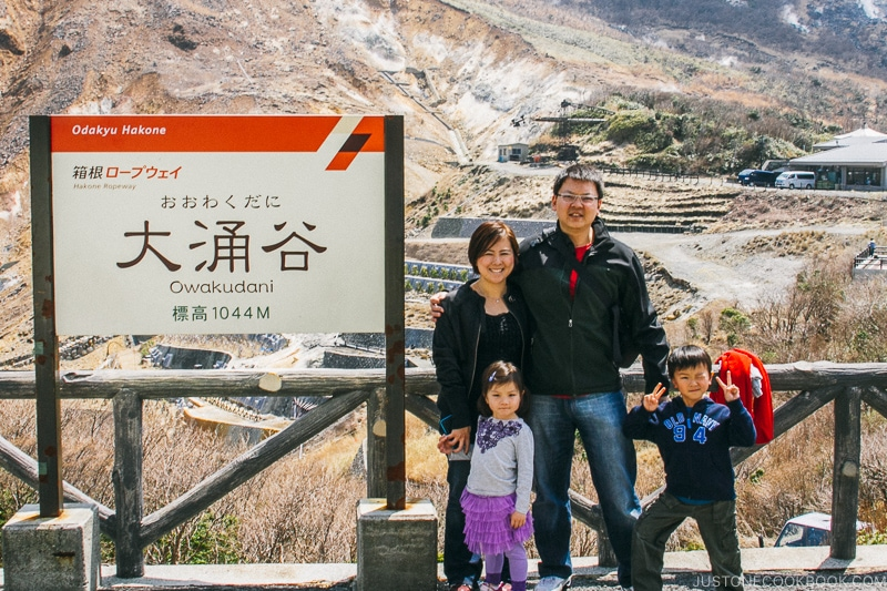 family next to Owakudani sign - Hakone Ropeway and Owakudani Hell Valley | www.justonecookbook.com