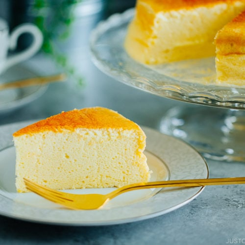 Japanese souffle cheesecake being served on a plate.