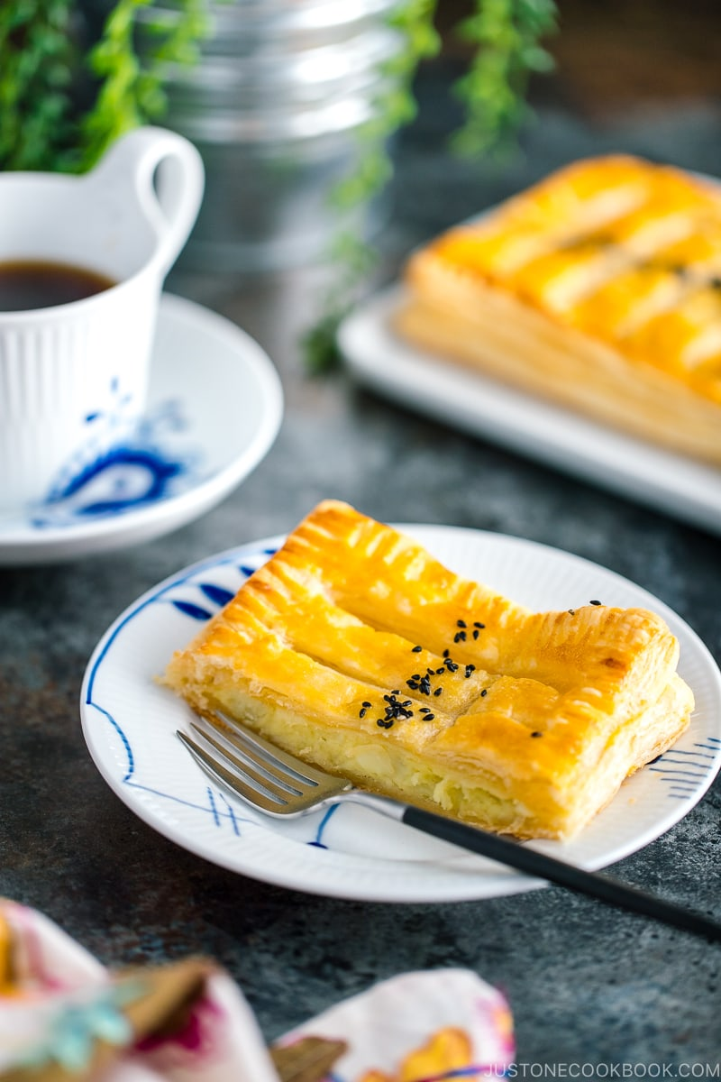 Japanese sweet potato pie served on plates along with coffee.