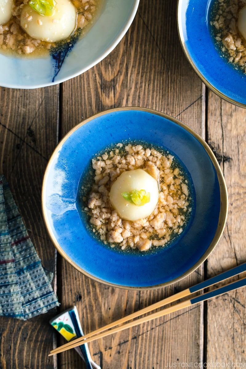 A beautiful Japanese bowl containing simmered Japanese turnips sitting on the thick minced chicken sauce.