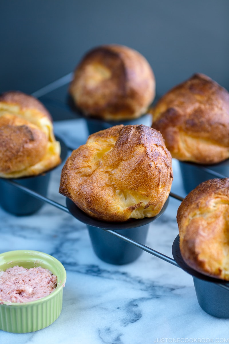 Popovers placed in the special popover pans along with strawberry butter.