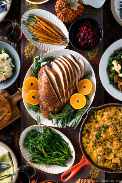 A table filled with Thanksgiving & holiday dishes.