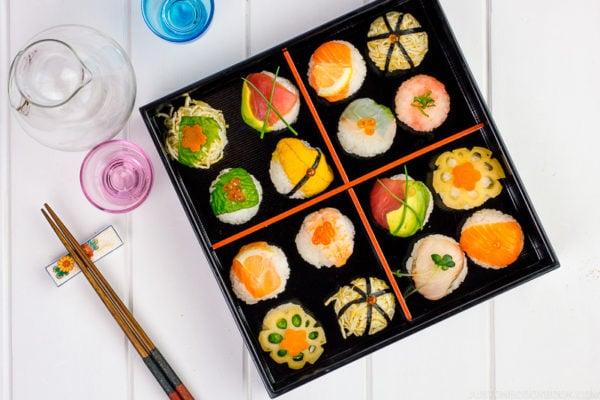 Temari sushi in a black lacquer box.