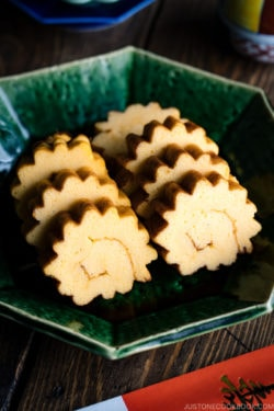 A green plate containing Datemaki, Japanese sweet rolled omelette, enjoyed during the New Years.