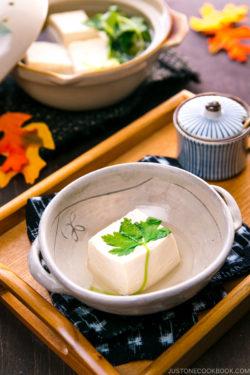 A Japanese ceramic bowl containing hot tofu.