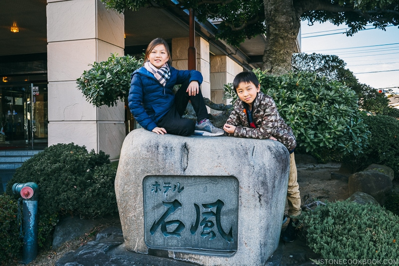 children next to Hotel Sekifu sign - Celebrate New Year at Isawa Onsen in Yamanishi | www.justonecookbook.com