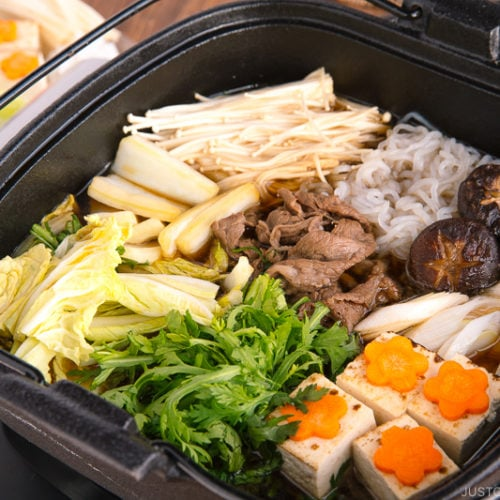 Sukiyaki cooked in a cast iron pot.