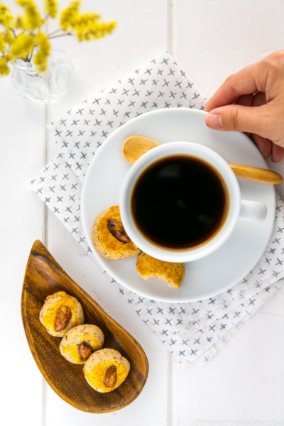Chinese almond cookies served with a cup of coffee.
