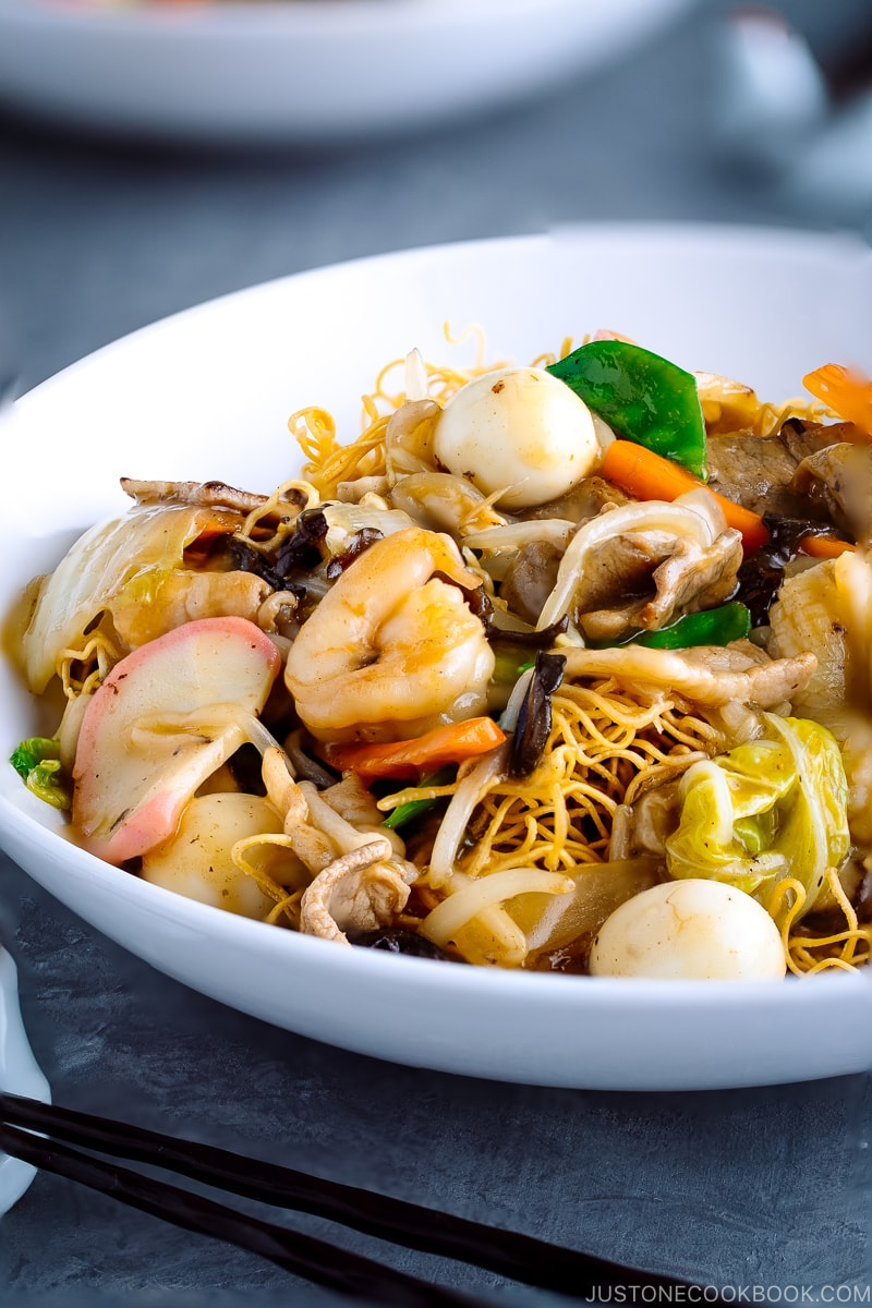 A white bowl containing Crispy Noodles with Seafood (Sara Udon).
