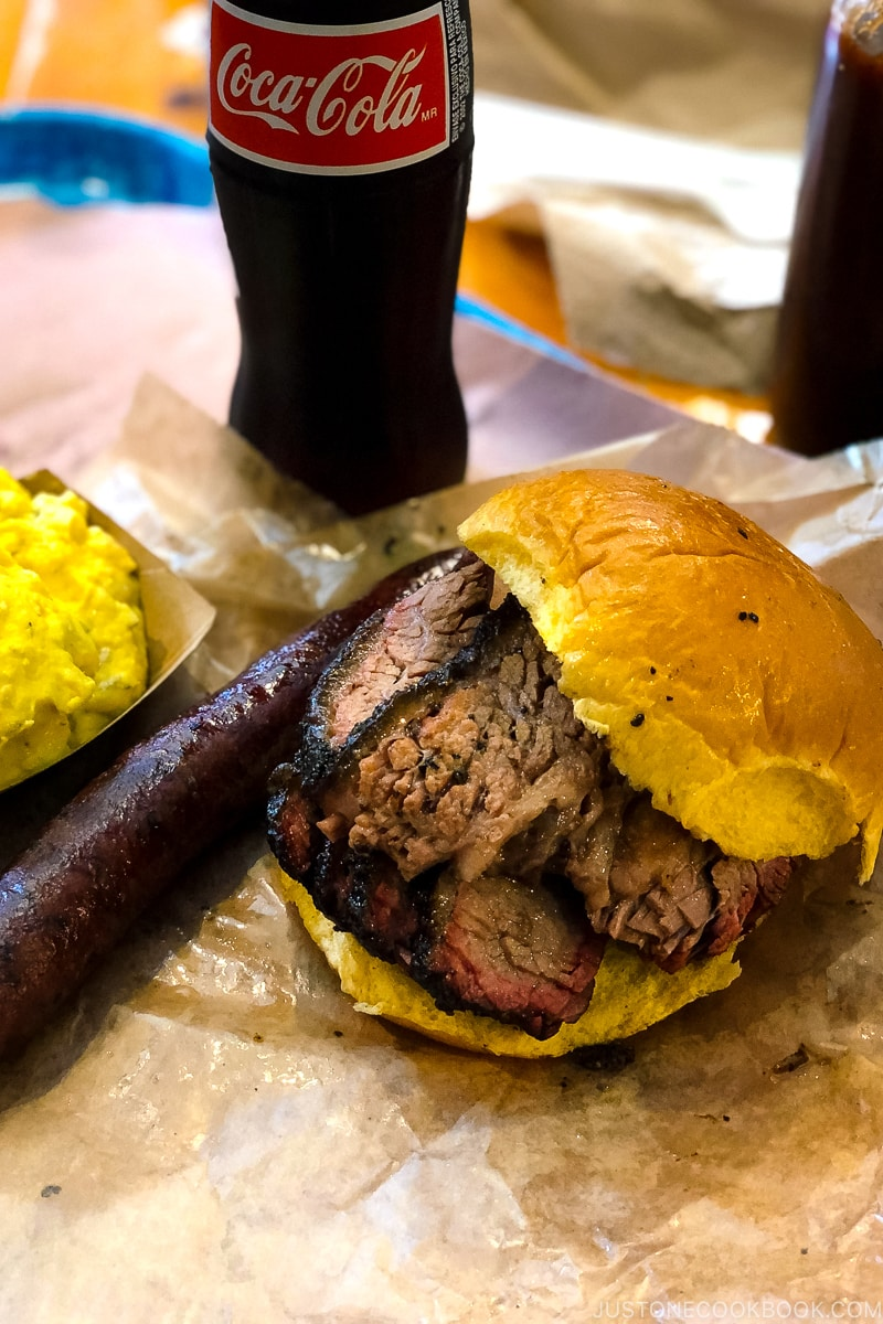 Beef brisket sandwich with sausage and potato salad at Franklin Barbecue in Austin TX