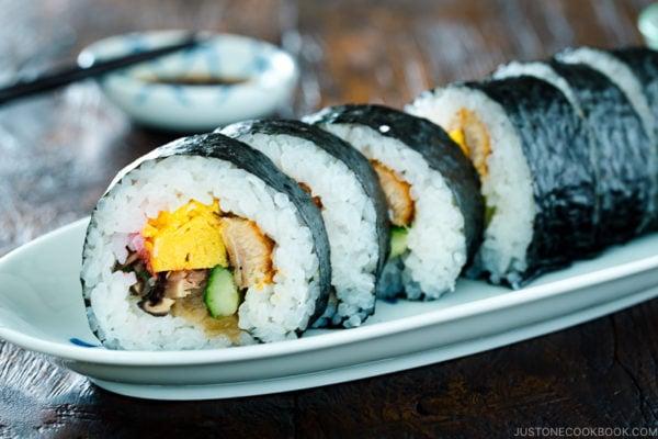 Futomaki (Maki Sushi) on a long white plate.