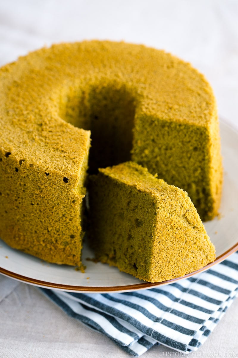 Green tea chiffon cake served on a white plate.