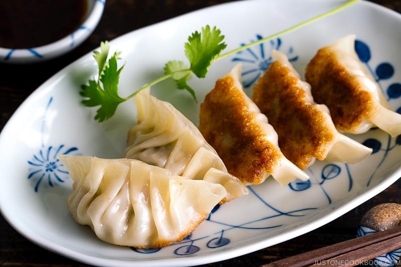 Gyoza served on a plate.