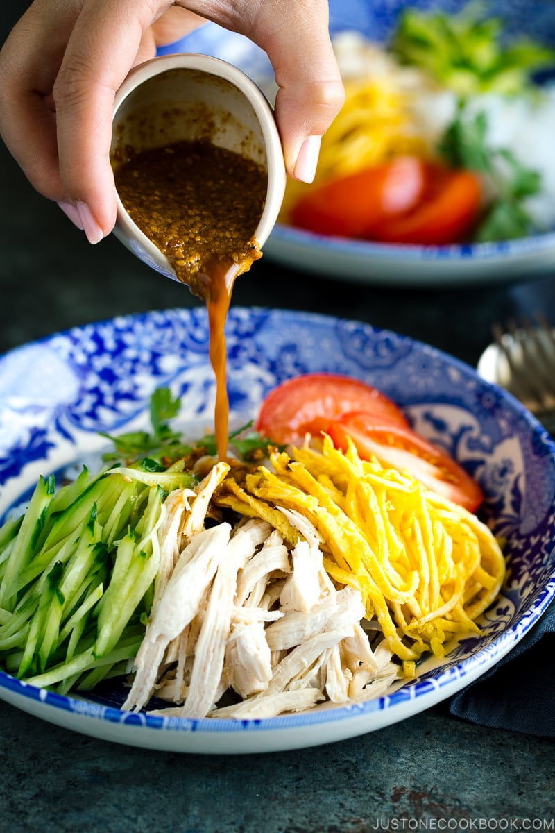A blue bowl containing cold and refreshing shirataki noodles with honey sesame dressing.