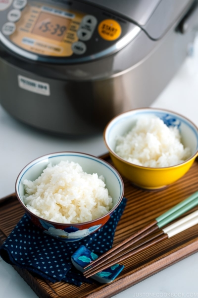 Japanese rice bowls containing perfectly cooked Japanese rice.