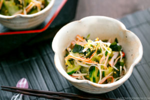 A flower shape bowl containing Japanese Cucumber Salad with Crab.